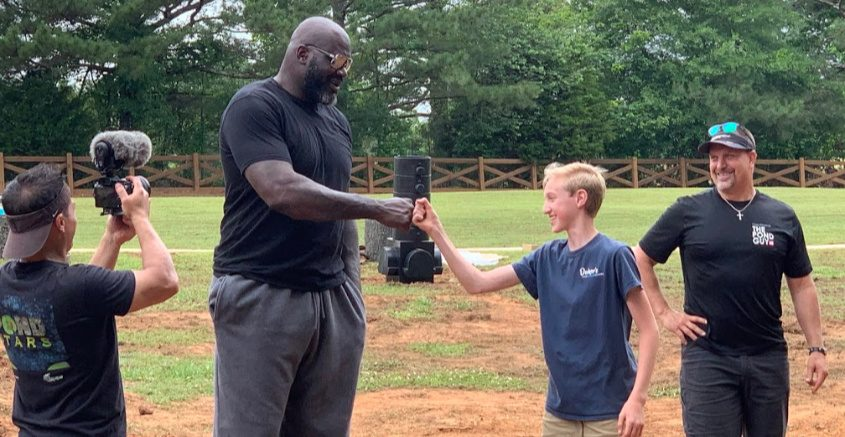 Shaquille O'Neal gives a fist bump to Nick Decker, with his dad, Alan Decker of Decker's Pondscapes in Pattersonville