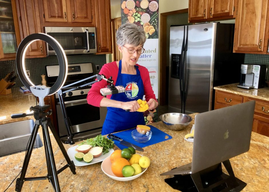 Deb Czech makes mango salsa in her kitchen, where she is teaching Food for Life classes online this summer.