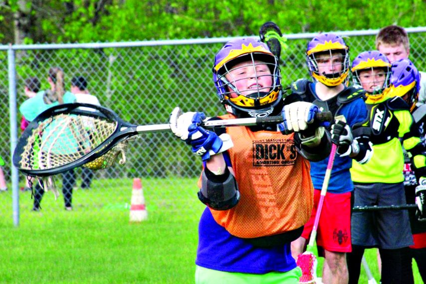 Amsterdam Rugged Lacrosse Academy player Logen Zabielski passes the ball during a practice on May 15, 2019.