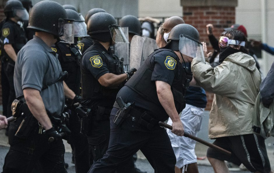 A protestor is shoved by an Albany Police officers on Arch Street near the South Station Saturday, May 30, 2020.