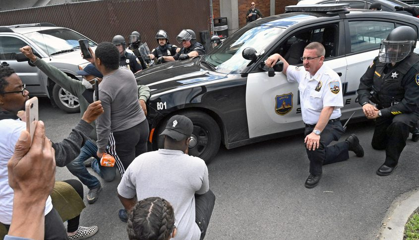 Schenectady Police Chief Eric Clifford and his officers take a knee during Schenectady's George Floyd protest