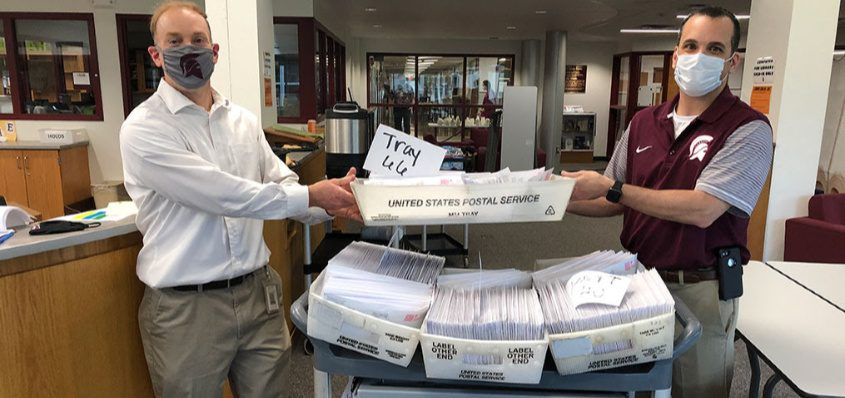 Burnt Hills-Ballston Lake staffers stuff envelopes this past weekend