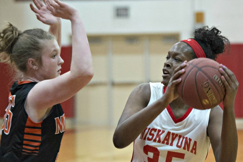 Olivia Owens, right, is shown during a high school game.