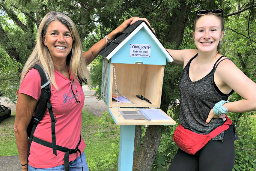 Carmen Brooks-Mulyca (left) and Mikayla Schaefer at the kiosk at the Kiwanis Park end of the Rotterdam Town Bicentennial path.