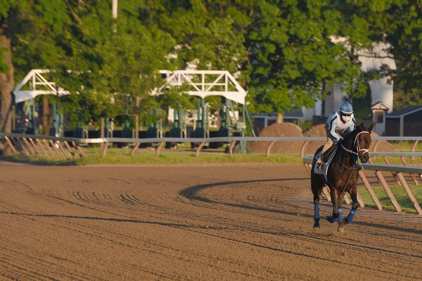 Somebody, a 5-year-old gelding trained by Jim Bond, gallops over the Oklahoma Training Track on Thursday.