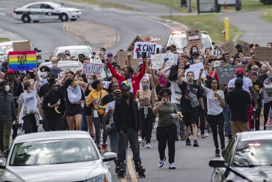 Protestors march on Hackett Boulevard in Albany Wednesday, June 3, 2020.