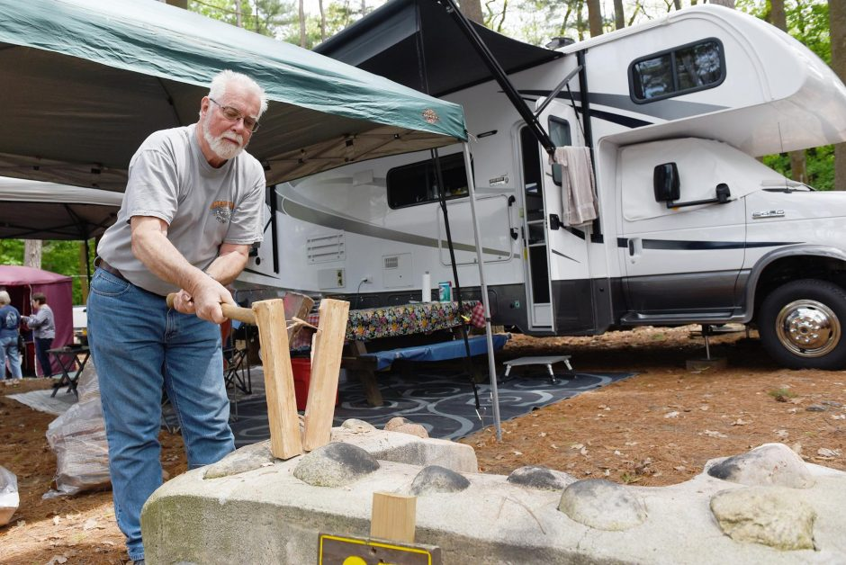 Ed Parrish, of Newport, Vt., chops wood while camping at the Lake George Battleground Campground in Lake George, May 30, 2019.