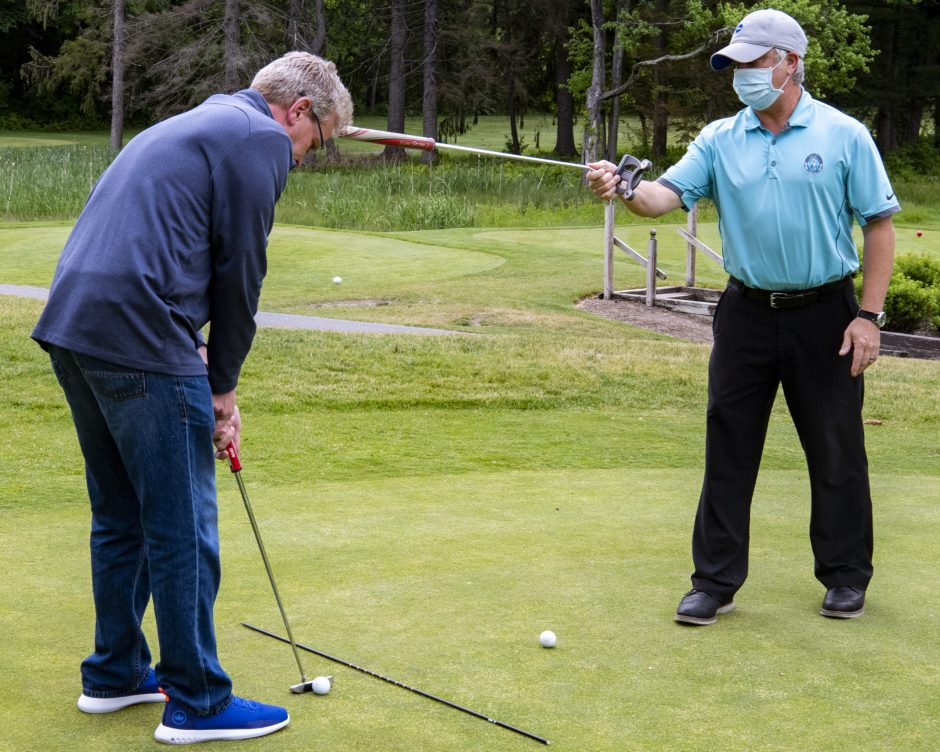 Schenectady Muni pro Matthew Daley holds a putting lesson on the practice green with Tony Riggi on June 2.