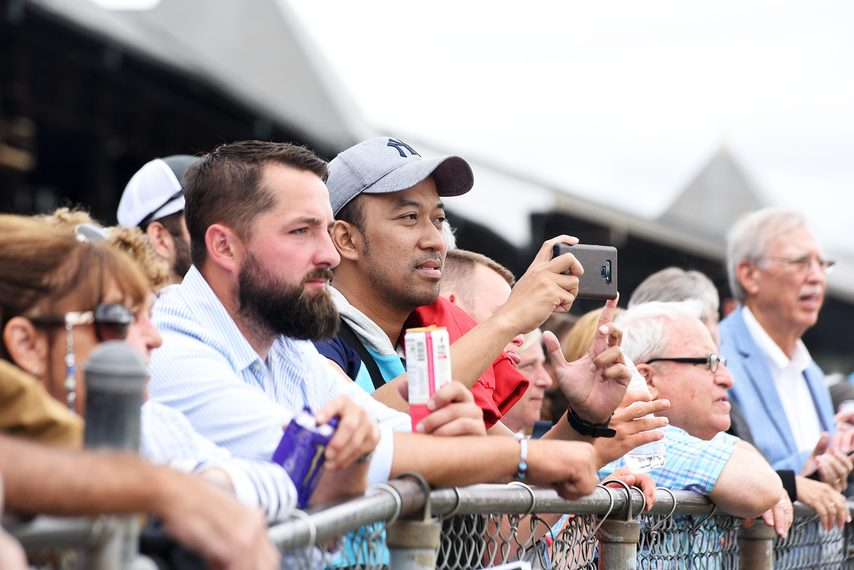 Patrons crowd up against the rail on closing day of the 2019 Saratoga Race Course meet.