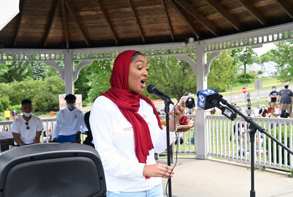 Ayah Osman reads a poem about the lives of black women at a protest outside Niskayuna Town Hall on Sunday.