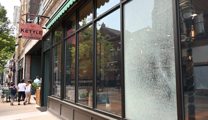 A shattered window seen at The Whistling Kettle on Jay Street Tuesday