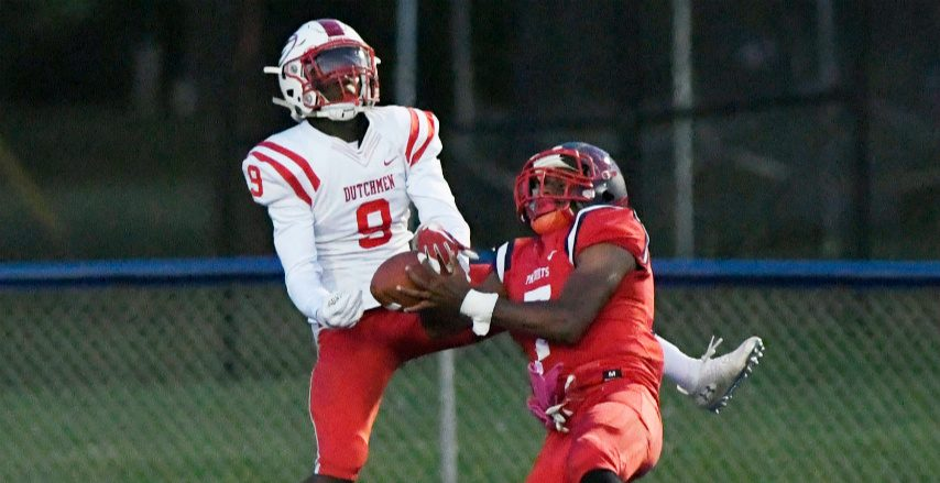 Schenectady senior Seven Terry, right, intercepts a pass last season against Guilderland.