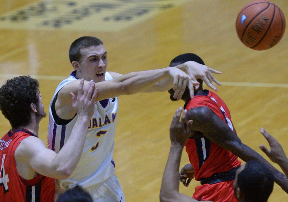 Joe Cremo of UAlbany makes a pass next to Emma Tselentakis of NJIT in a 2015 game. NJIT is joining the America East Conference.