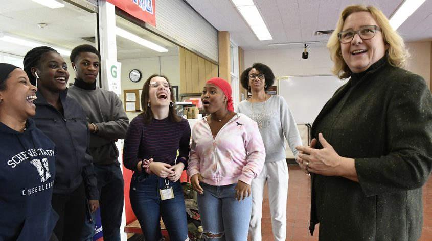 Retiring Schenectady High School Principal Diane Wilkinson visits with students outside her office in January.