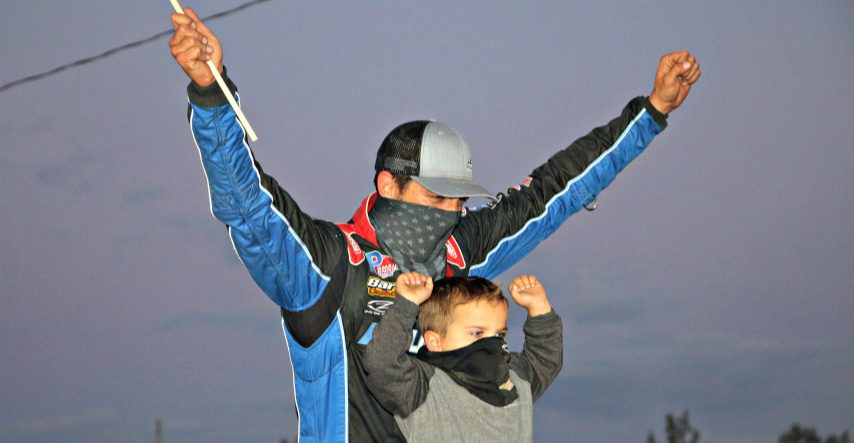 Stewart Friesen and his son, Parker, celebrate in victory lane Sunday night at Fonda Speedway.