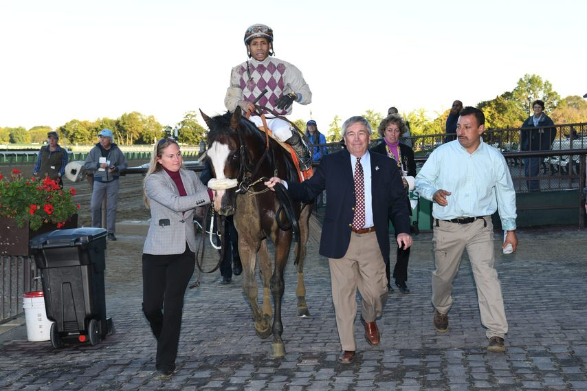 Sackatoga's Jack Knowlton, right, leads Tiz the Law into the Belmont winner's circle after he won the Champagne last fall.