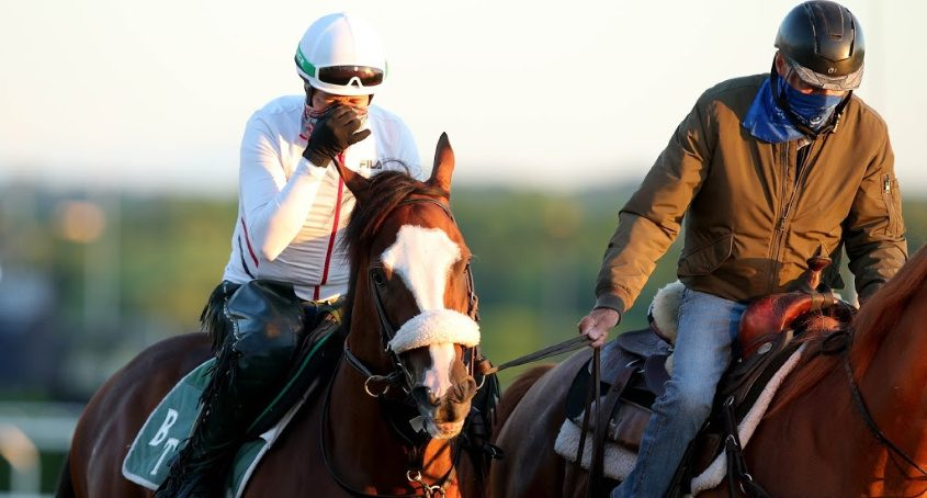 Trainer Barclay Tagg, right, leads Tiz the Law onto the track for an easy workout at Belmont Park on Wednesday morning.