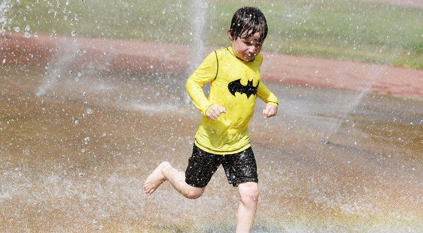 Rocco Tolmie, 7 of Saratoga Springs, cools off on a hot day at the splash pad at East Side Rec in Saratoga Springs July 10, 2019