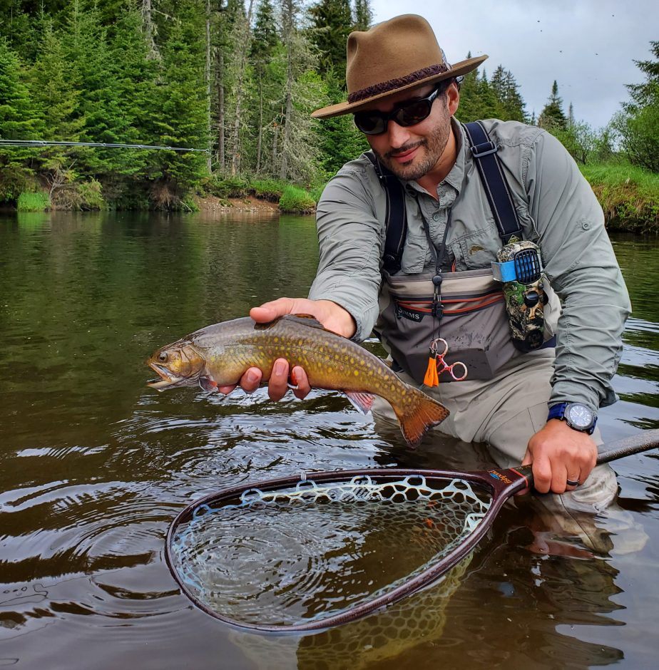 Gabe Lopez of Hagaman holds up a sizable, native Brook Trout, miles off the beaten path in the heart of the Adirondacks.