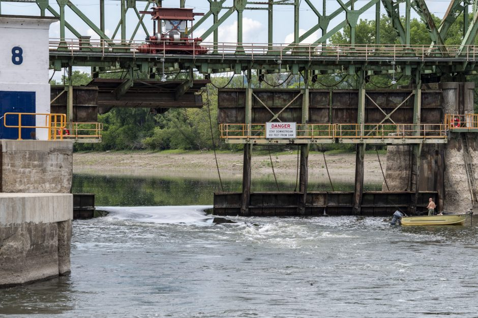 A lone fisherman casts off in front of the lowered gates at Lock 8 off Rices Road in Rotterdam Friday, June 19, 2020.