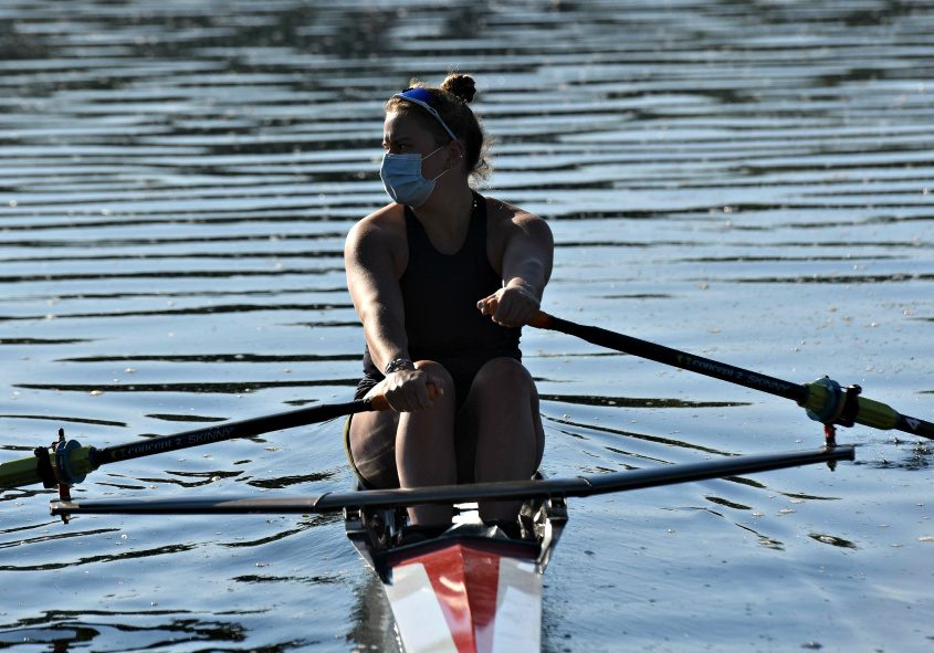 Zoe Hasbrouck, a rising junior at Brown University, takes her single out onto Fish Creek from the SRA boathouse.