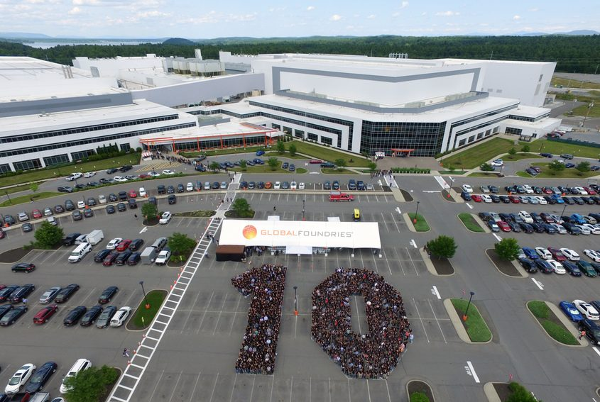 Employees mark the 10th anniversary of GlobalFoundries' Malta facility in July 2019.
