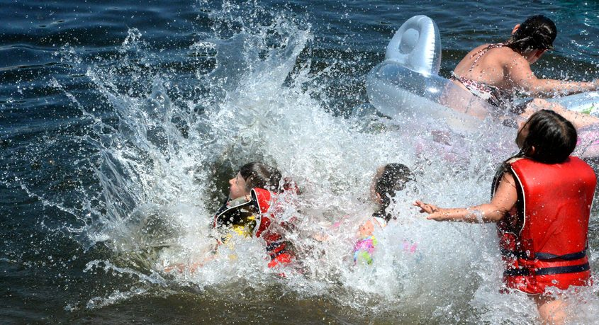 The LaBelle family swims at Great Sacandaga Lake near the causeway on South Main St. Ext. on Sunday