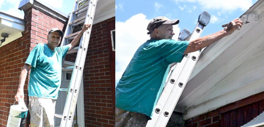 Raul Class paints trim on a home on Arbor St. in Rotterdam for Umbrella.