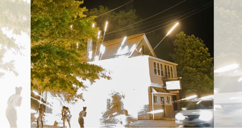 A firework malfunctions and explodes at the intersection of Backus and Albany streets Tuesday