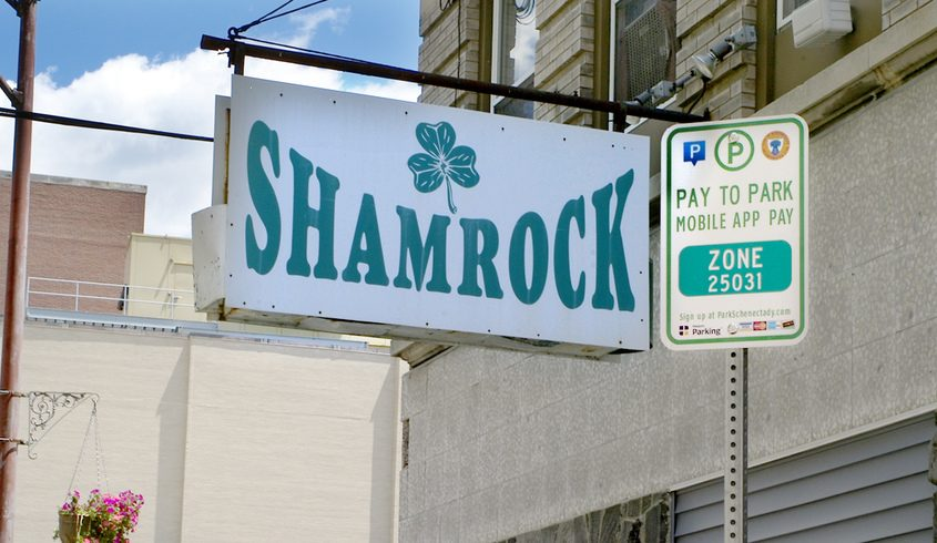 A pay to park sign at the Shamrock on Clinton Street Thursday