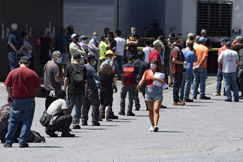 Employees are lined up outside the Keymark factory in Fonda on Friday afternoon.