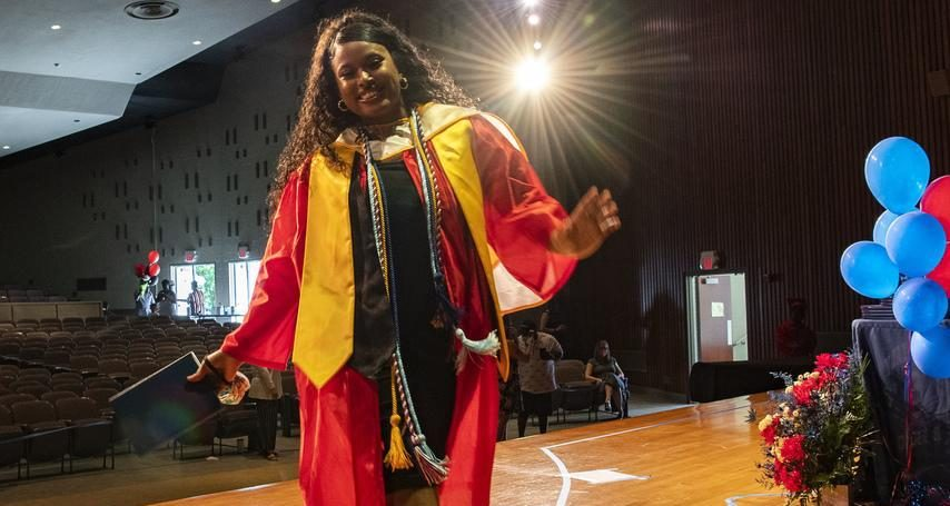 Schenectady High senior class president Maram Ahmed crosses the stage during Friday's graduation ceremony.