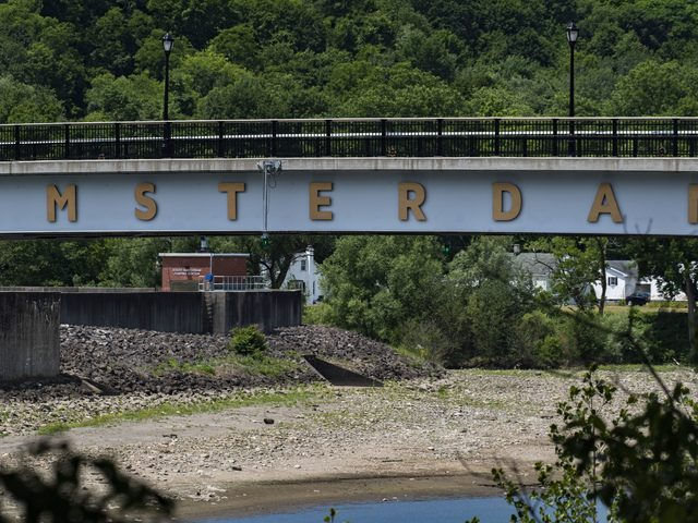 The Mohawk River bed is visible from below the pedestrian bridge in Amsterdam due to low water levels on Friday.