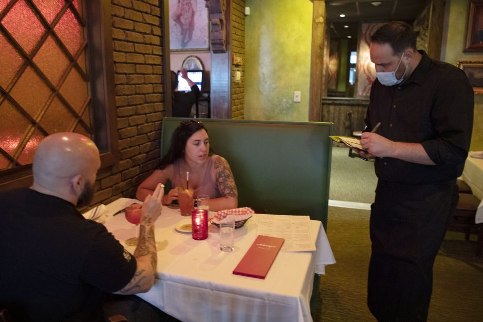 Nick Eluyer and Anna Conti of Schenectady order appetizers from Johnny's Restaurant waiter Justin Kirker on June 25, 2020.