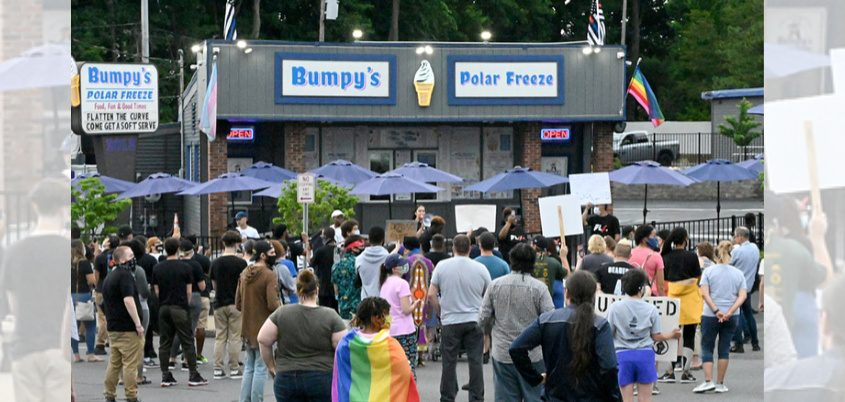 Protesters rally outside Bumpy's Polar Freeze in Schenectady on Sunday.
