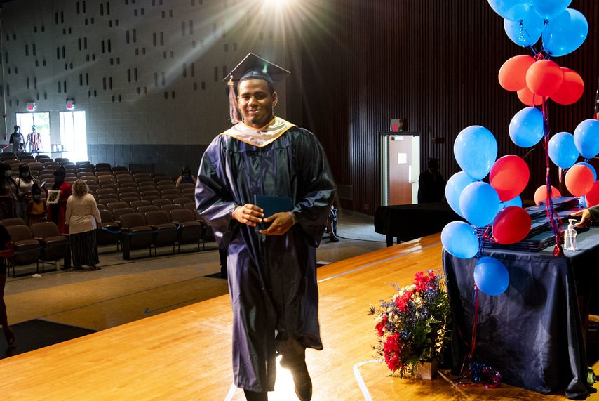 Schenectady High senior Seven Terry walks across the stage during graduation last Friday.