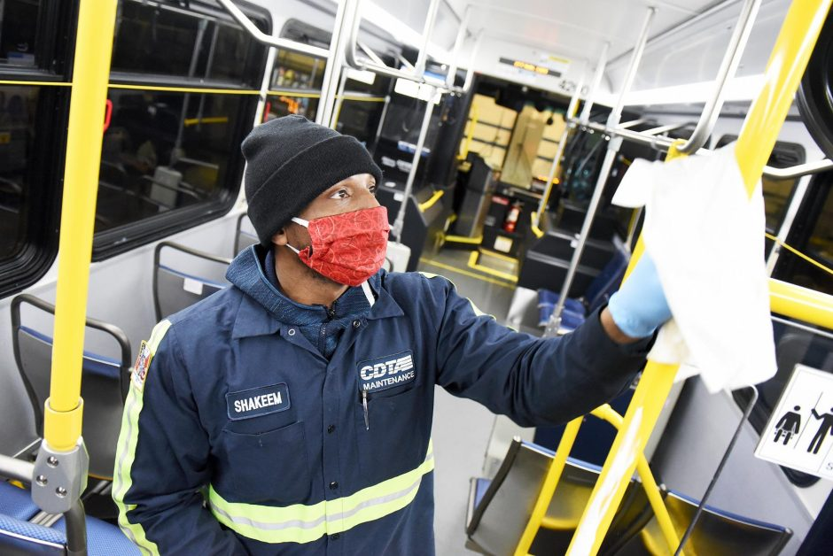 Shakeem Plater deep-cleans a bus at the Albany CDRA Maintenance Headquarters in May