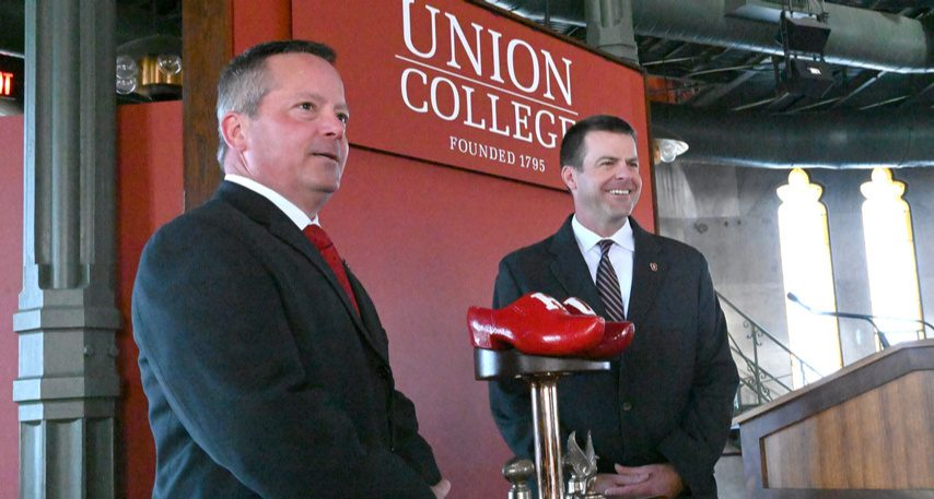 RPI coach Ralph Isernia, left, and Union's Jeff Behrman pose with the Dutchman Shoes Trophy last fall.