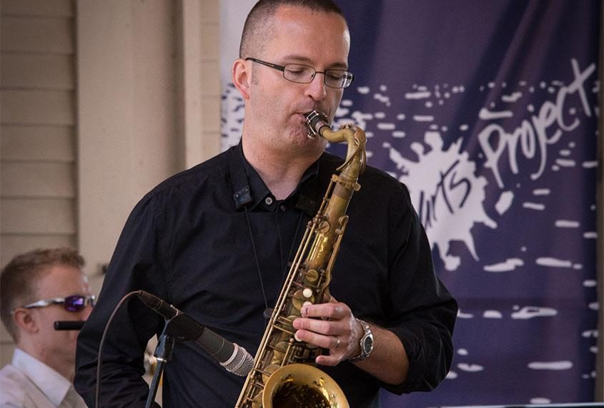 Brian Patneaude performs with a quartet in 2017.