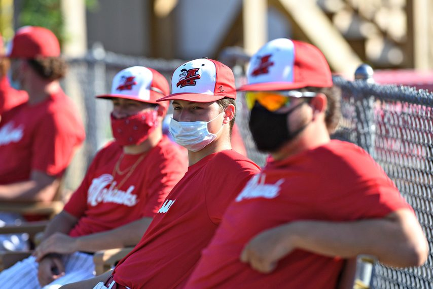 Amsterdam Mohawks pitchers keep their face masks on in the bullpen during their doubleheader against the Albany Dutch.