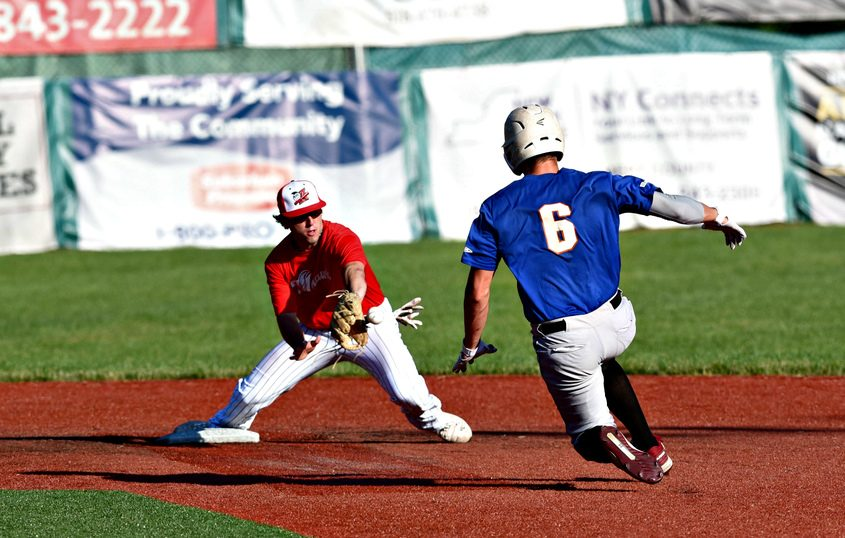 Amsterdam's Nick Kondo awaits a throw as Albany's Luke Gold slides into second base Monday night at Shuttleworth Park.
