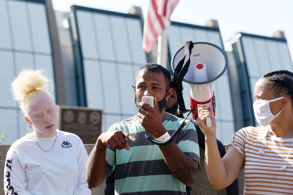 Yugeshwar Gaindarpersaud speaks at a protest in front of Schenectady Police Department.