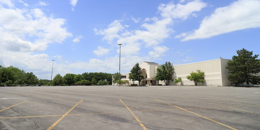A parking lot is deserted on June 11 at the idled Crossgates Mall in Guilderland.
