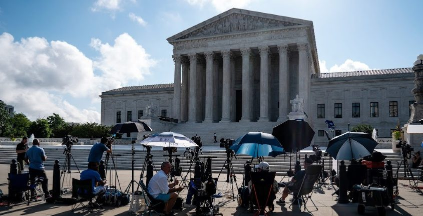 Reporters gather outside the Supreme Court Building ahead of decisions Thursday