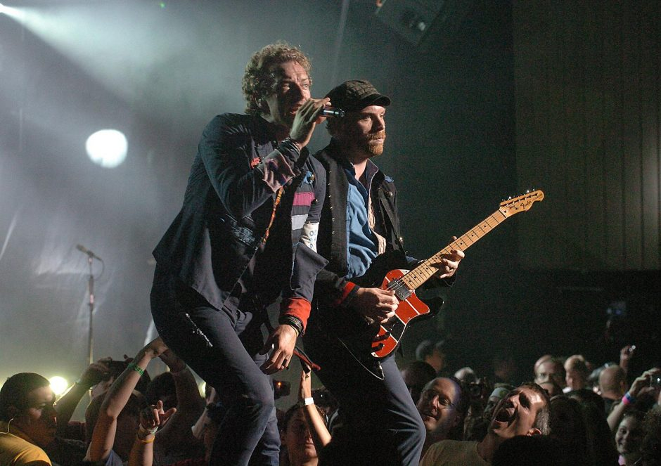 Lead singer Chris Martin and guitarist Jonny Buckland perform with British group Coldplay during their concert at SPAC in 2009.