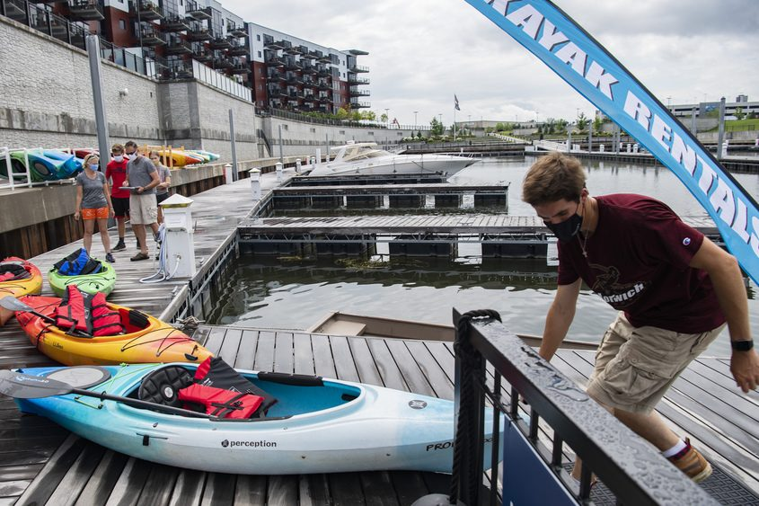 Tom Chase of Upstate Kayak Rentals sets up a kayak for a guest Friday at Mohawk Harbor in Schenectady.