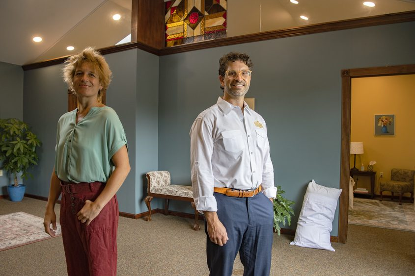 Managing partner Amy Alcaide and owner Nick Pavoldi stand in the lobby of Bodywork Professionals in Niskayuna on Friday.
