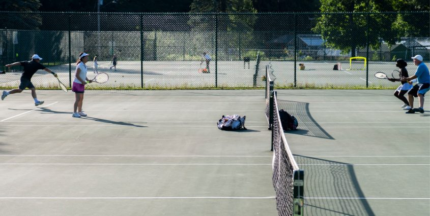 Games carry on at the tennis courts in Central Park on July 21.