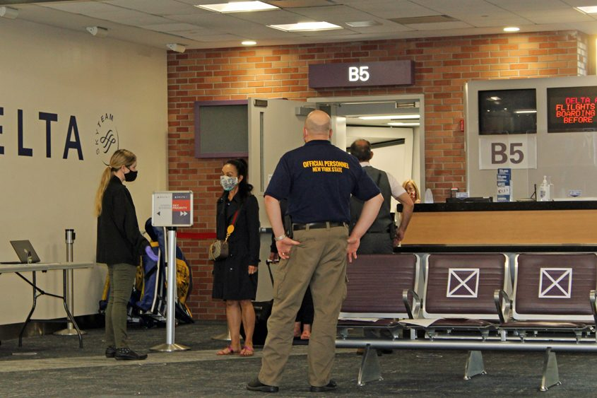 State Department of Health personnel work at Albany International Airport on July 9.