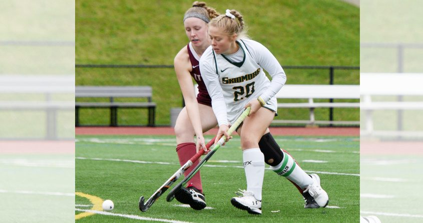 Skidmore's Sarah Winters with the ball against Union's Isabel Lubin during their Liberty League field hockey game last season.